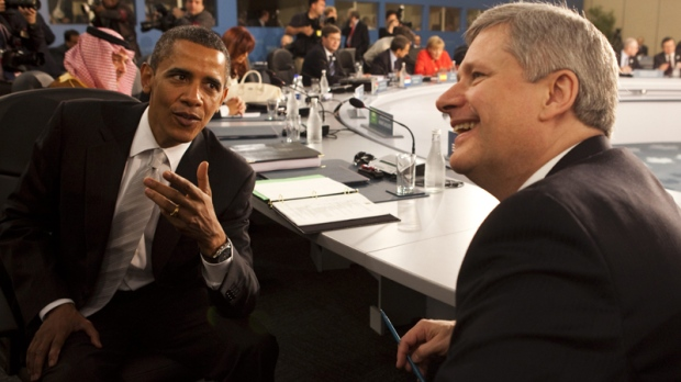 Prime Minister Stephen Harper speaks with U.S. President Barack Obama during a plenary session at the G20 summit in Toronto on Sunday, June 27, 2010. (Sean Kilpatrick / THE CANADIAN PRESS)