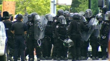 Riot police move in an a group outside the detention centre on Eastern Avenue and Pape in Toronto, Sunday, June 27, 2010.