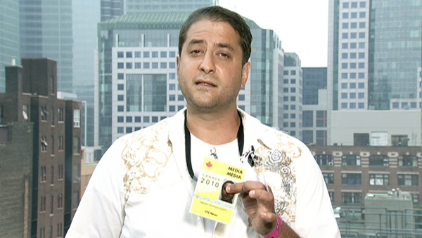 Farzad Fatholahzadeh, a CTV News Channel producer, shows the media accreditation he was wearing when police arrested him in Toronto on Saturday, June 27, 2010.