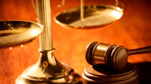 The scales of justice and a judge's gavel are pictured. (File)