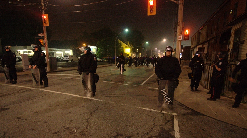 Riot police stand ready during a protest at Eastern Avenue and Pape early Sunday morning, Sunday, June 27, 2010. (Tom Stefanac / CTV News)