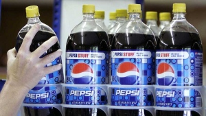 A customer takes a bottle of Pepsi from a display at T & P Grocery in Hosford, Fla., April 21, 2008. (AP / Phil Coale)