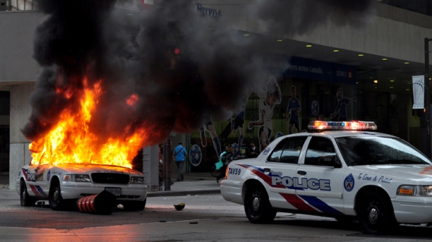 A police car burns after being set on fire by anti G20 protesters in downtown Toronto on Saturday, June 26, 2010. (Asad Munir / MyNews.CTV.ca)