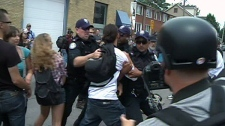 Police move in and grab known anarchist Chris Bowen from a crowd outside the detention centre on Eastern Avenue and Pape in Toronto, Sunday, June 27, 2010.