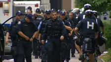 A massive police presence moved in to make the raid near Spadina and College in downtown Toronto, Sunday, June 27, 2010.