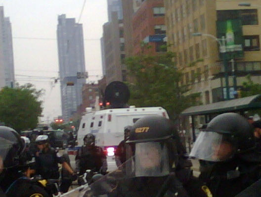 The LRAD Acoustic Communication Device (sound cannon) is moved into position at Queen and Spadina in downtown Toronto, Sunday evening, June 27, 2010. (Lisa LaFlamme / CTV News)