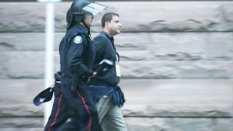 Farzad Fatholahzadeh, a CTV News Channel producer, is seen moments after being arrested by police during a protest rally in Toronto on Saturday, June 26, 2010.
