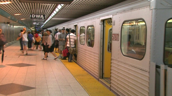TTC riders get on a subway at Bloor-Yonge Station after it re-opened in Toronto, Sunday, June 27, 2010.