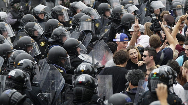 Riot police push against a crowd during a street demonstration on the closing day of the G20 Summit in Toronto, Sunday, June 27, 2010. (AP / Carolyn Kaster)
