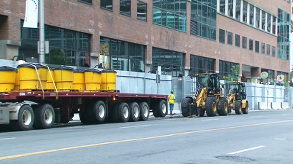 City crews begin to take down the large G20 security fence in downtown Toronto on Monday, June 28, 2010.