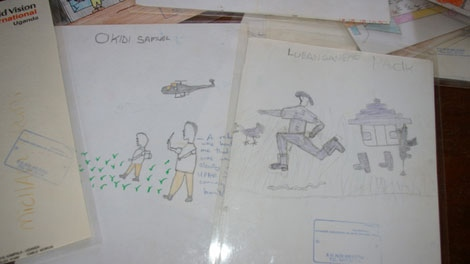 Drawings made by child soldiers at the Children of War Centre in Gulu, Uganda. Counsellors use art therapy to gauge trauma of formerly abducted persons.