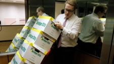 Attorney Peter Janci moves boxes full of records from the Boy Scouts of America in Portland, Ore.