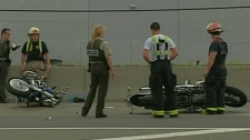 Surete du Quebec investigators at the scene of a motorcycle crash on Highway 30 in Candiac that left two family members dead, and one critically injured. (Monday, June 28, 2010)