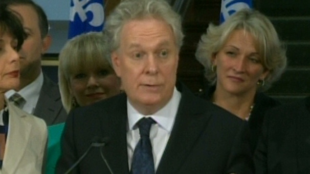 Premier Jean Charest is seen speaking to the media in this undated image.