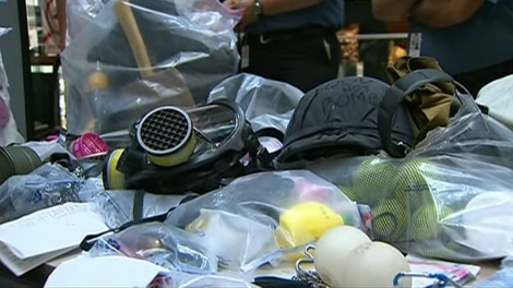Weapons seized over the G20 weekend are displayed at police headquarters in Toronto on Wednesday, June, 29, 2010.