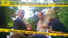 """FBI agents gather in front of the two-story residence in Yonkers, N.Y. where two suspected Russian secret agents Vicky Pelaez and a man known as """"Juan Lazaro"""" were arrested on Monday June 28, 2010.  (AP / The Journal News, Shawn Cohen)"""