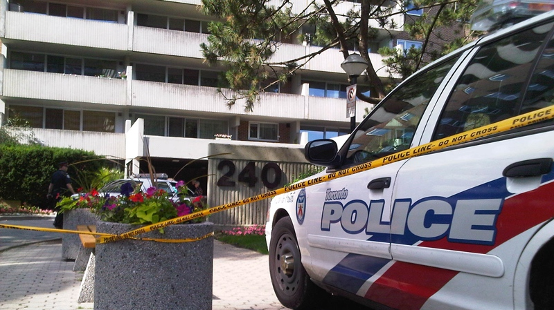 Police investigate after a Toronto woman was found dead in a west-end apartment on Wednesday, June 30, 2010. (Keith Hanley / CTV News)
