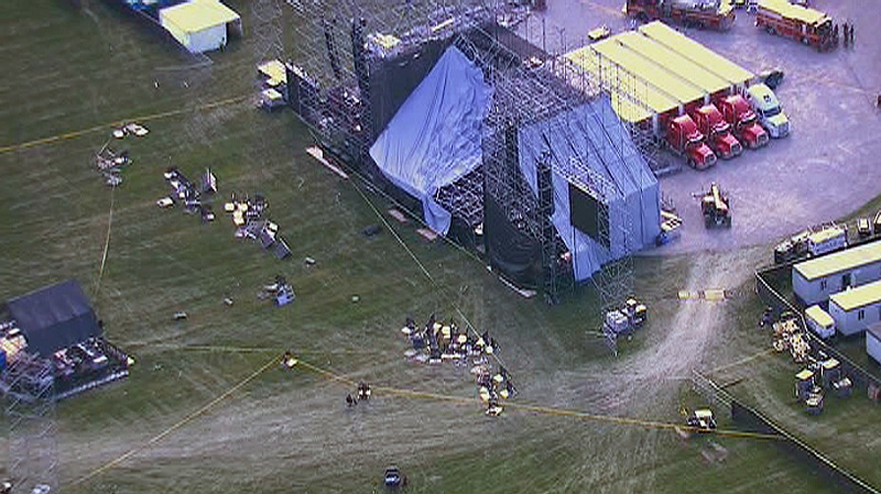 Police officials are shown at the scene of a stage collapse at Downsview Park in Toronto on Saturday, June 16, 2012.