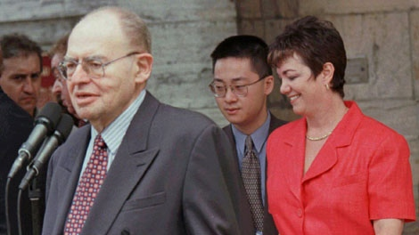 Newly appointed Deputy Prime Minister Herb Gray talks with reporters following a cabinet shuffle swearing-in ceremony in Ottawa Wednesday while former Deputy PM Sheila Copps walks by on June 11, 1997. (CP PHOTO)