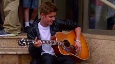 Justin Bieber plays an impromptu concert in front of Stratford's Avon Theatre