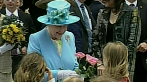 The Queen is presented with flowers from a group of young children at the Canadian Museum of Nature in Ottawa, Wednesday, June 30, 2010.
