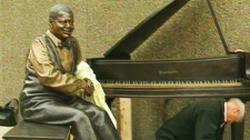 This life-sized bronze sculpture of piano legend Oscar Peterson will be unveiled outside on the grounds of the National Arts Centre, near Parliament Hill, in Ottawa, by Queen Elizabeth on Wednesday, June 30, 2010.
