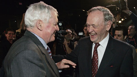 Former prime ministers John Turner, left and Jean Chretien meet at the Liberal Leadership Convention Friday, Dec. 1, 2006 in Montreal. Chretien served as Turner's deputy prime minister. (CP PHOTO/Adrian Wyld)