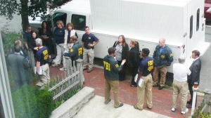FBI agents are seen outside 35B Trowbridge Road in Cambridge, Mass., a residence owned by Donald Heathfield and Tracey Foley on Sunday, June 27, 2010. (AP / Richard Stanley)