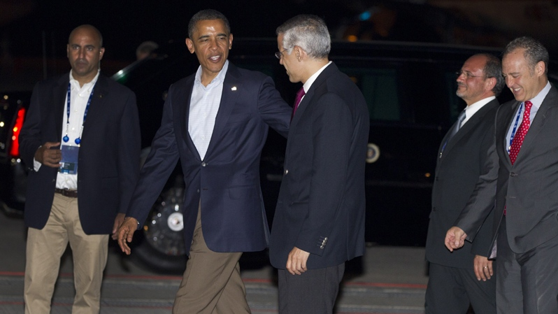 U.S. President Barack Obama talks with Ambassador Julian Ventura as he arrives at Los Cabos International Airport to attend the G20 Summit, Sunday, June 17, 2012, in Los Cabos, Mexico. (AP Photo/Carolyn Kaster)