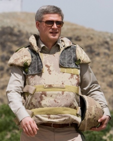 Prime Minister Stephen Harper walks along the Dahla Dam and Irrigation System on the Arghandab River, during a trip to Afghanistan on Thursday May 7, 2009. (THE CANADIAN PRESS/Sean Kilpatrick)