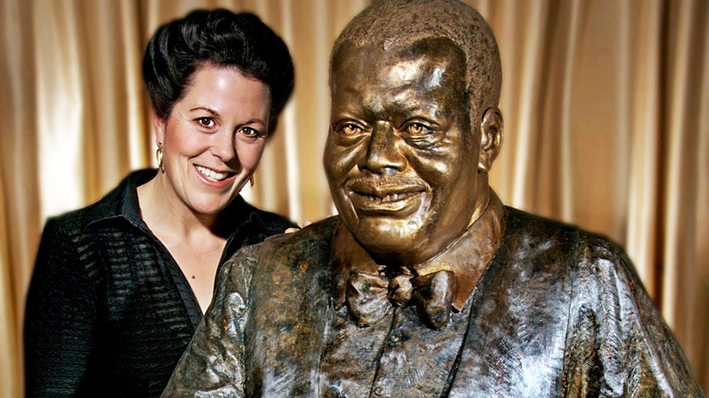 Sculptor Ruth Abernethy with her partially finished statue of late piano legend Oscar Peterson is shown in a handout photo. (J.R. Ribbee /  THE CANADIAN PRESS)