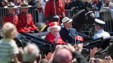 Queen Elizabeth and the Duke of Edinburgh arrive for Canda Day celebrations on Parliament Hill in Ottawa on Canada Day Thursday, July 1, 2010. (Pawel Dwulit / THE CANADIAN PRESS)