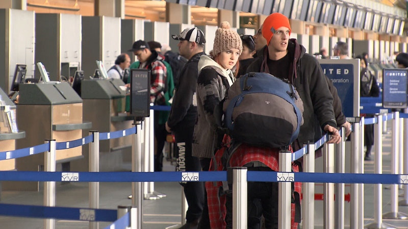 Passengers line up to board a flight at Vancouver International Airport. June 18, 2012. (CTV)