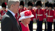 Queen Elizabeth walks with Canadian Prime Minister Stephen Harper as she arrives to take part in Canada Day celebrations on Parliament Hill in Ottawa, Thursday July 1, 2010. (Adrian Wyld / THE CANADIAN PRESS)