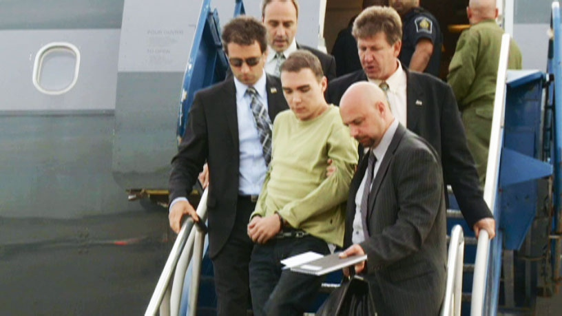 Luka Magnotta is seen arriving off a plane in Quebec, Monday, June 18, 2012.