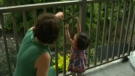 Lisa Chandler and her 15-month-old daughter Lali, testing the dangers of balconies.