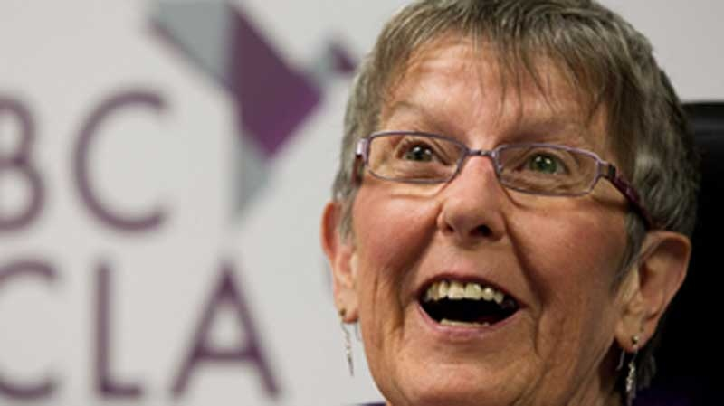 Gloria Taylor, who suffered from Lou Gehrig's disease and won a doctor-assisted suicide challenge in B.C. Supreme Court, smiles during a news conference in Vancouver, B.C., on Monday, June 18, 2012. (Darryl Dyck / THE CANADIAN PRESS)