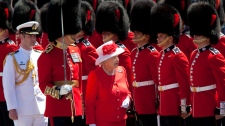 Queen Elizabeth II inspects the Honour Guard as she arrives to take part in Canada Day celebrations on Parliament Hill in Ottawa on Thursday, July 1, 2010. (Sean Kilpatrick / THE CANADIAN PRESS)