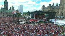 An aerial image taken from video shows the crowd gathered for Canada Day festivities as the Queen speaks on Parliament Hill in Ottawa, Thursday, July 1, 2010.