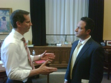 Ontario's Premier Dalton McGuinty (left) speaks with CTV Toronto's Paul Bliss at Queen's Park on Friday, July 2, 2010.
