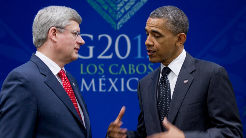 President Barack Obama gestures as he speaks during a bilateral meeting with Canada's Prime Minister Stephen Harper during the G20 Summit, Tuesday, June 19, 2012, in Los Cabos, Mexico. (AP / Carolyn Kaster)