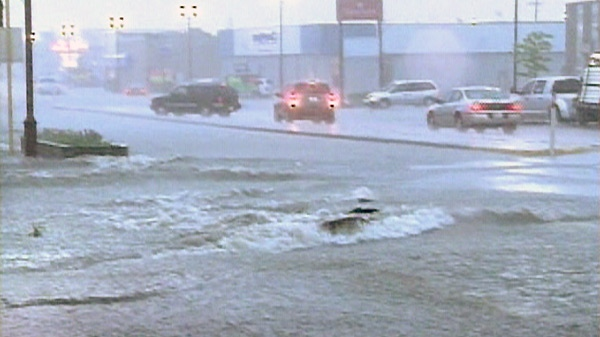 Flooded streets are seen in downtown Yorkton, Sask. on Thursday, July 1, 2010.