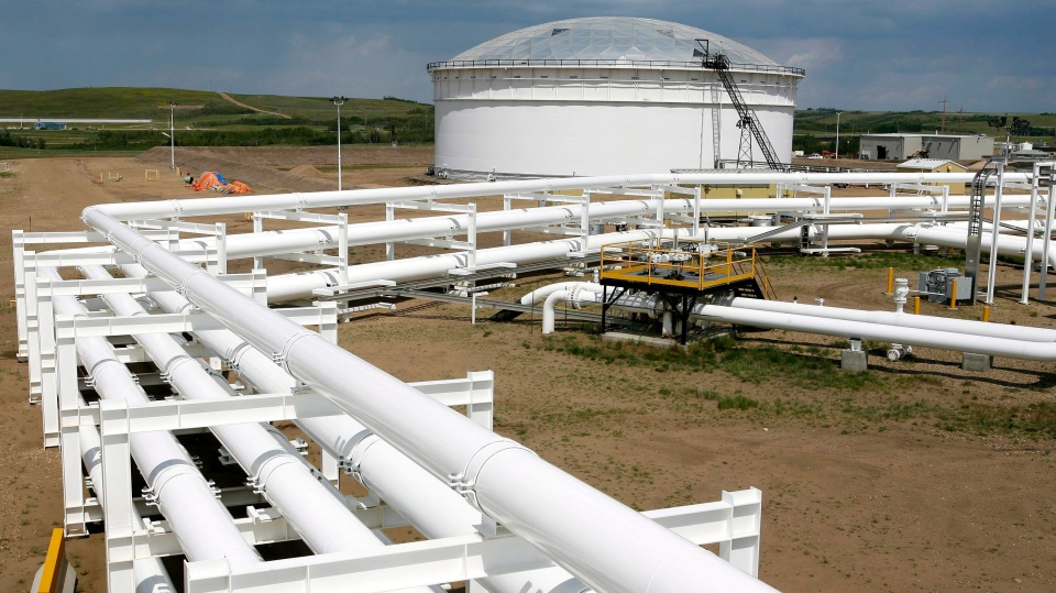 An oil pipeline and tank storage facility is shown in Hardisty, Alta., June 20, 2007.
