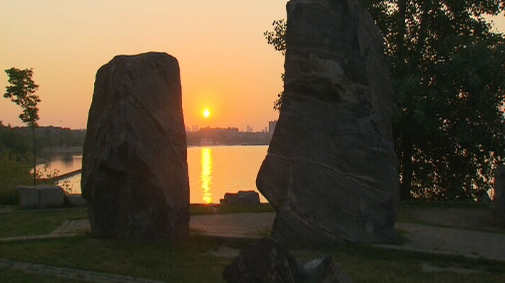 The sun rises over Lake Ontario in Toronto during a heat wave on Wednesday, June 20, 2012.