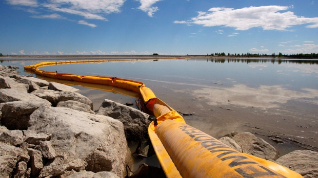 Oil from a pipeline leak coats a pond near Sundre, Alta.