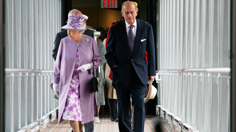 Queen Elizabeth and The Duke of Edinburgh arrive in the new terminal at the James Armstrong Richardson International Airport in Winnipeg, Saturday, July 3, 2010. (John Woods / THE CANADIAN PRESS)