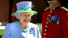 The Queen smiles as she prepares to leave the Ottawa Airport enroute to Winnipeg, Manitoba on Saturday July 3, 2010. (Fred Chartrand / THE CANADIAN PRESS)