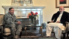 Afghan President Hamid Karzai, right, and commander of NATO forces in Afghanistan U.S. Gen. David Petraeus talk during a meeting at the Presidential Palace in Kabul, Afghanistan, on Saturday, July 3, 2010. (AP / Massoud Hossaini)