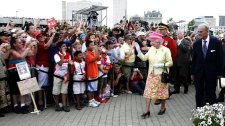 The Queen escorted by the Duke of Edinburgh walks about at The Forks in Winnipeg on Saturday, July 3, 2010. (John Woods / THE CANADIAN PRESS)