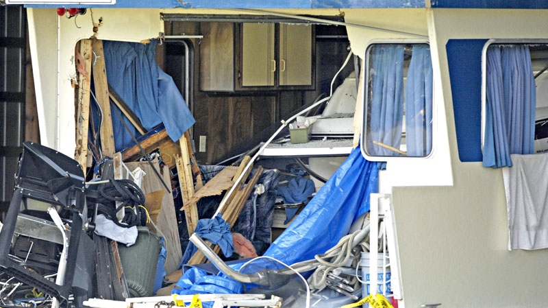 A speed boat is seen inside of a houseboat at a storage area behind Captain's Village Marina in Shuswap Lake, B.C., on July 4, 2010. The speed boat crashed into the houseboat late Saturday night in Magna Bay killing one and injuring others. (Daniel Hayduk / THE CANADIAN PRESS)